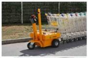 Tracteur pousseur pour chariots supermarché