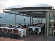 Abri terrasse restaurant à toile aérée