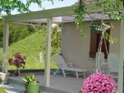 Auvent pour porte en aluminium - Les tonnelles adossées à la maison ou installées au milieu du jardin