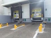 Cale roues de camion automatique - Traction du véhicule jusqu'au quai