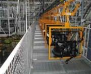 Convoyeur à chaînes double voie motorisé 2000 kg - Pour charges de 10 à 75 kg soit  jusqu'à 2000 kg