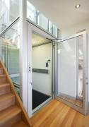 Elevateur handicape à vérin latéral - Hydraulique à double câble  -  Cabine fermée de type ascenseur