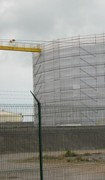 Filet d'échafaudage pour maintenance de sites industriels - Filets pare-gravats  -  Pose rapide sur les échafaudages