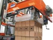 Housseuse automatique - Production : 25 à 100 palettes/heure