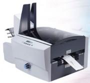 Imprimante d'adresses - Capacité : 30 000 enveloppes par heure.