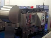 Laveuse de caisse avec retour sur opérateur - Cadence de 600 caisses / heure max.