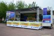 Location camion podium événementiel - Camion 19 tonnes avec scène de 25 à 45 m² avec loge
