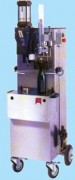 Machine à vin Boucheuses-Museleuses 200 bouteilles par heure - Capacité : entre 200 à 600 bouteilles par heure.
