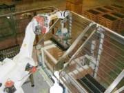 Machine à vins robotisé en caisses fil pour le remuage - Cadence: 4000 bouteilles par heure