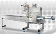 Machine conditionneuse emballeuse - Avec système de soudure transversale - Bande d'alimentation à taquets
