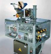 Machine d'étiquetage supérieur - Vitesse de production maxi : 18.000 pièces par heure