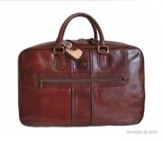 Petit sac de voyage en cuir - Fermeture zippée équipée d'un cadenas - Coloris fauve