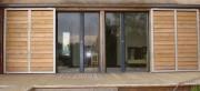 Porte coulissante en profilés aluminium - Avec habillage bois