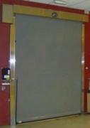 Porte industrielle en acier - En acier inoxydable  -  Equipée d'un moteur
