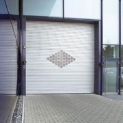 Porte industrielle en acier avec rideaux - Decotherm