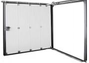 Porte sectionnelle à déplacement latéral - Retombée de linteau réduit : 130 mm avec moteur - Refoulement réduit : 150 mm