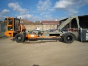 Porteur benne à bras hydraulique - Charge utile totale (Kg) : 25000 - Poids machine : 8880 kg