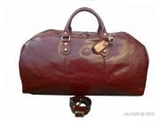 Sac de voyage en cuir de vachette - Dimension (L x h)  : 60 x 30 cm - Fermeture zippée avec cadenas gainé de cuir