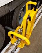 Système pour immobiliser le camion sur le quai - Prise d'appui à l'intérieur du rail.