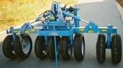 Tasse avant 8 roues - Tasseur à pneus Sumosaure XL