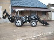 Tracteur a chargeur retrocaveuse