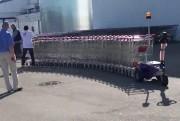 Tracteur pousseur pour caddies de supermarché - Capacité de 2 tonnes - plus de 25 caddies - télécommandé