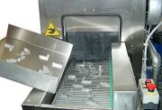 Tunnel de lavage pour pièces mécaniques